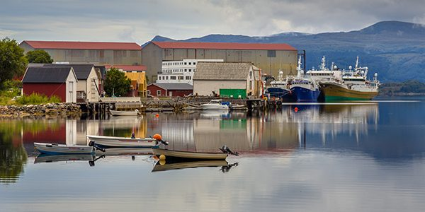 Small harbor Local economy concept in Norwegian fjord