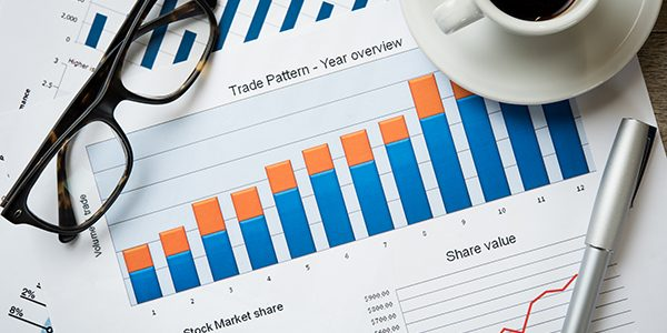 Close up of business document on office desk. Top view of business charts and graphs of stock market. Closeup of growing financial chart.